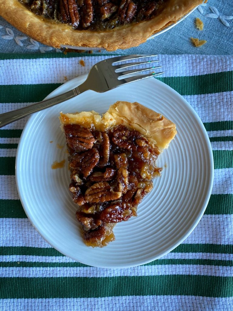 A slice of smoked candied pecan pie