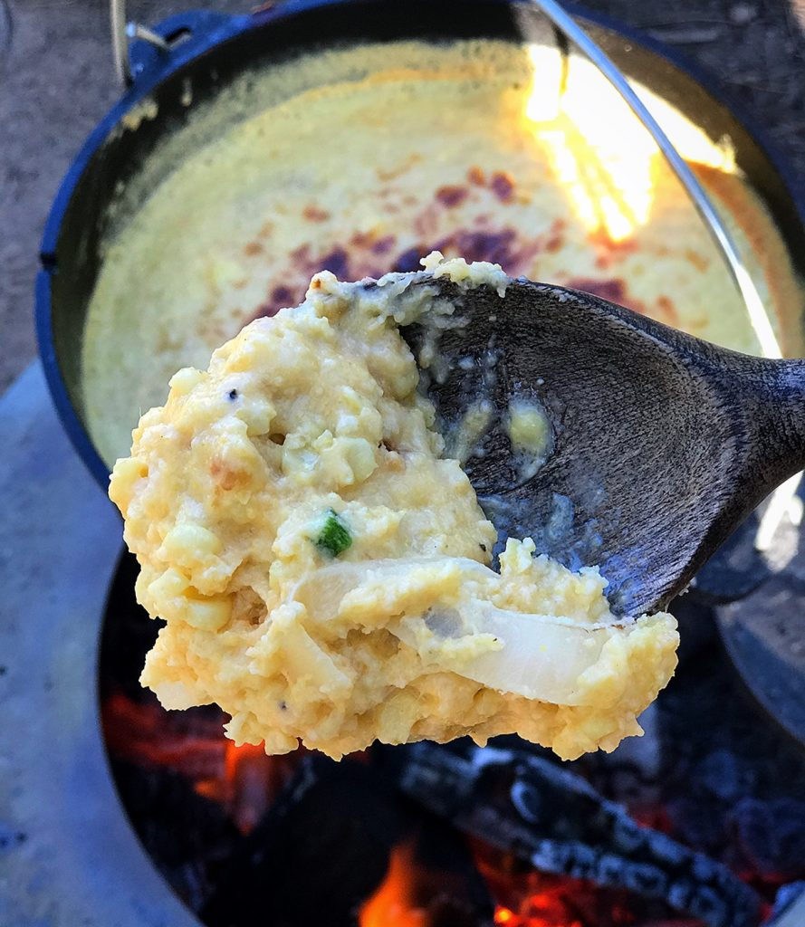 Southern corn pudding fresh out of the cast iron dutch oven!