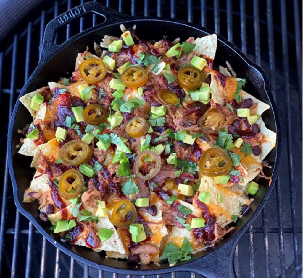 Pulled pork nachos finished and on the grill. How many are you eating?