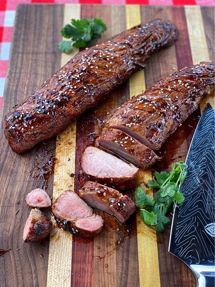 Smoked Teriyaki Pork Tenderloin sliced on the cutting board.